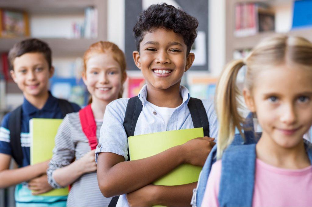 child holding green folder