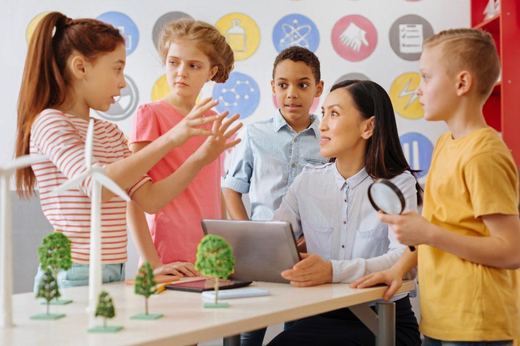 children in group around teacher