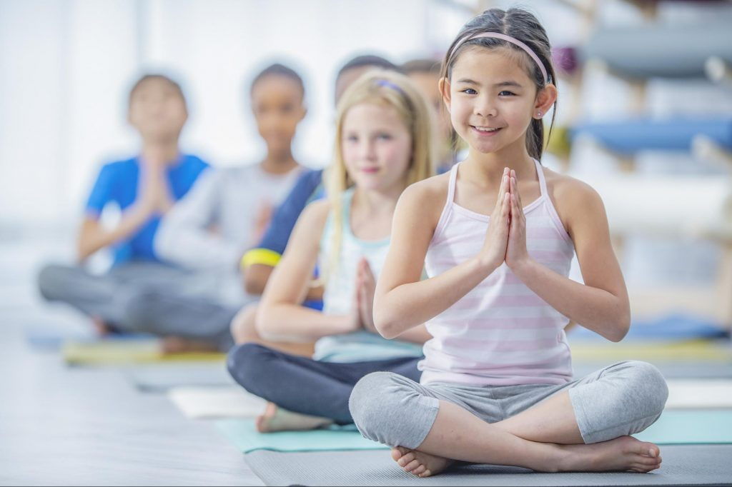 children sitting in yoga pose