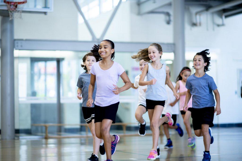 children in gym running