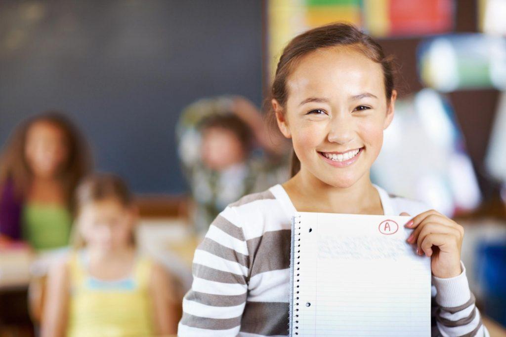 child holding notebook