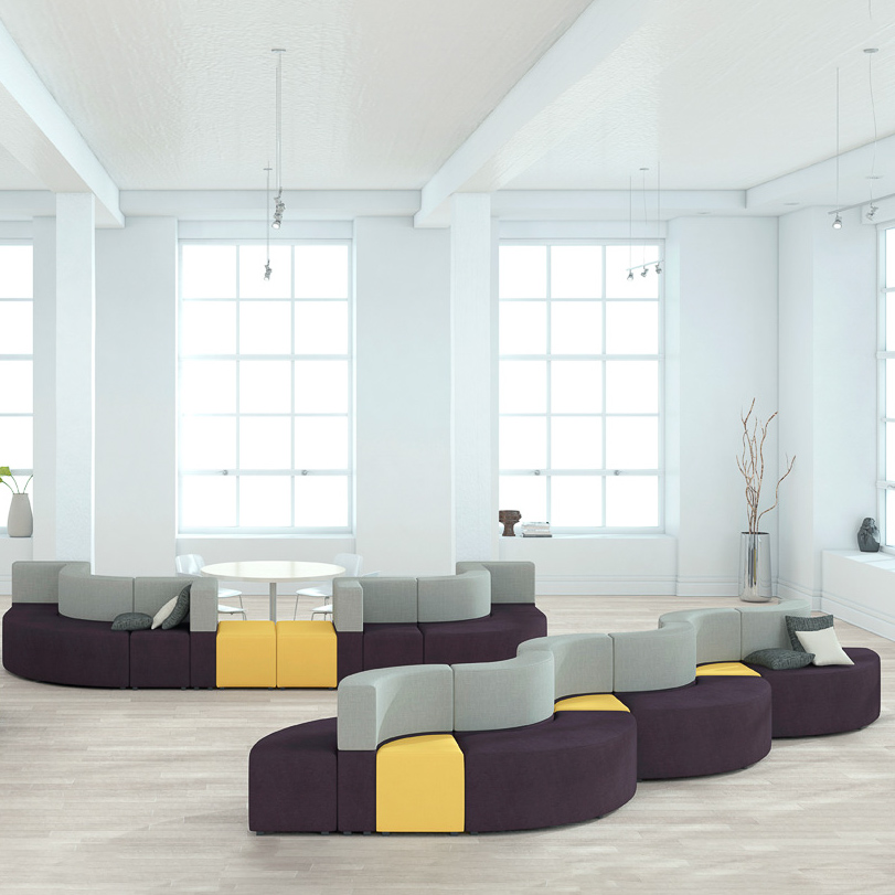 Curved lounge couches in bright white room