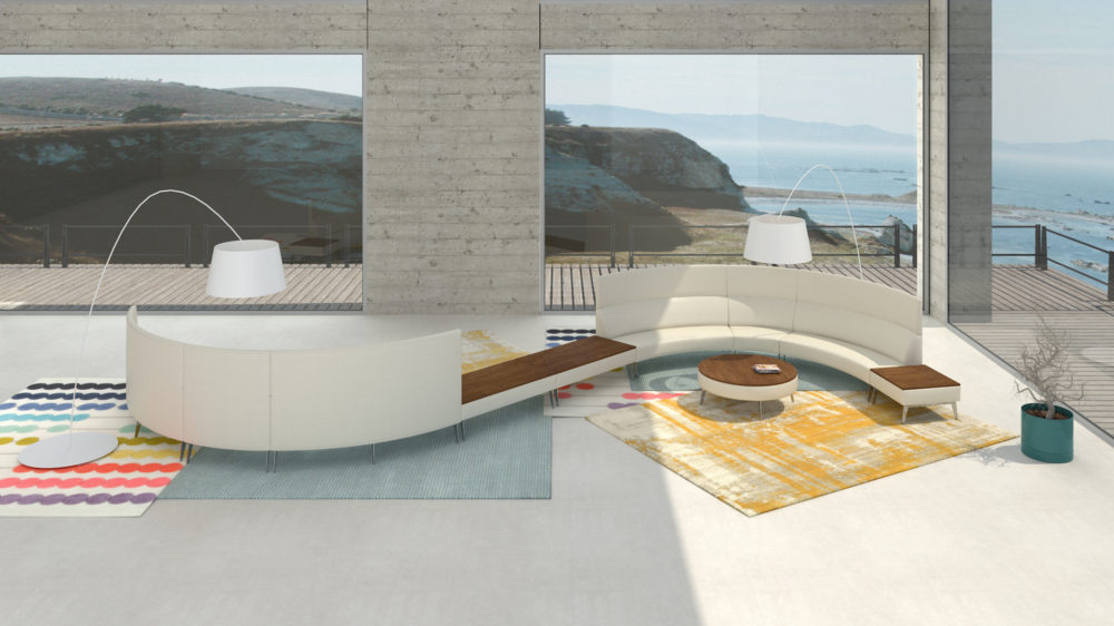 Lounge couch and tables in modern room overlooking ocean