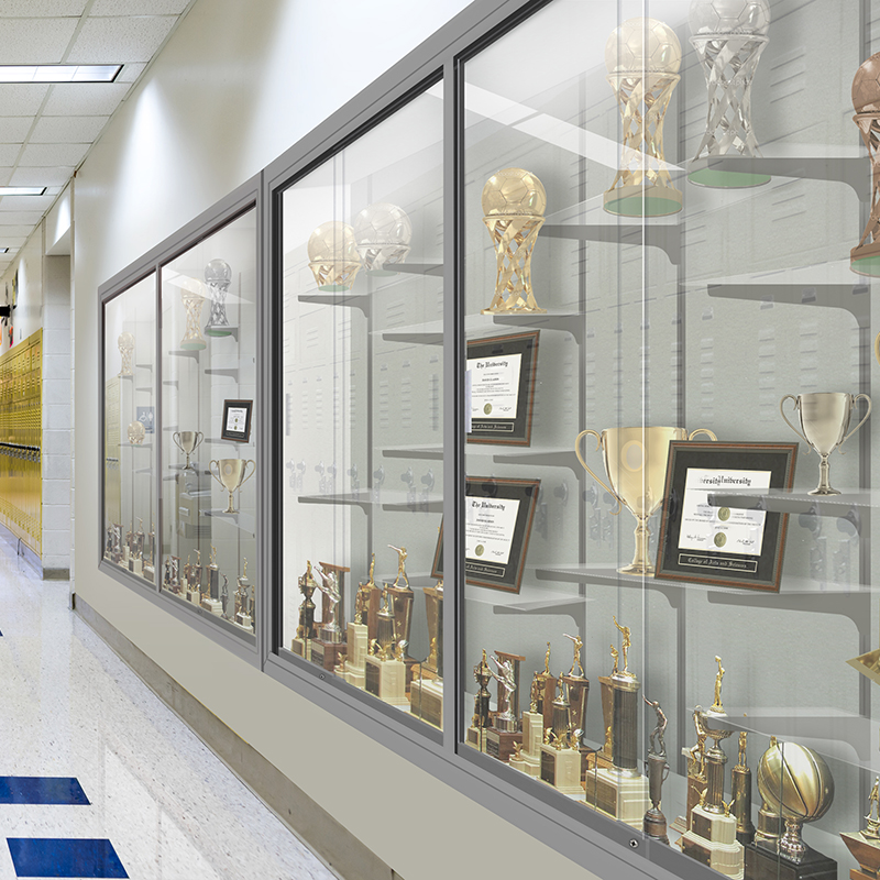 Glass display case with trophies